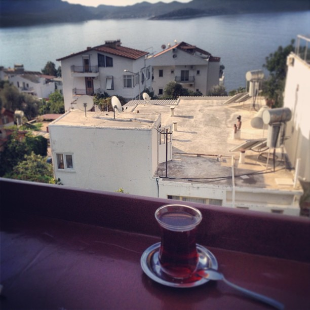 Having tea on our hostel's terrace in Kas, Turkey with a view of the sea.